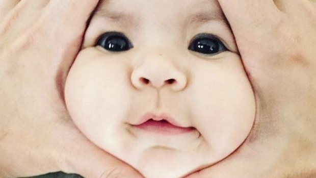 Parents Squish Their Babies' Faces to Make an Instagram-Worthy Post